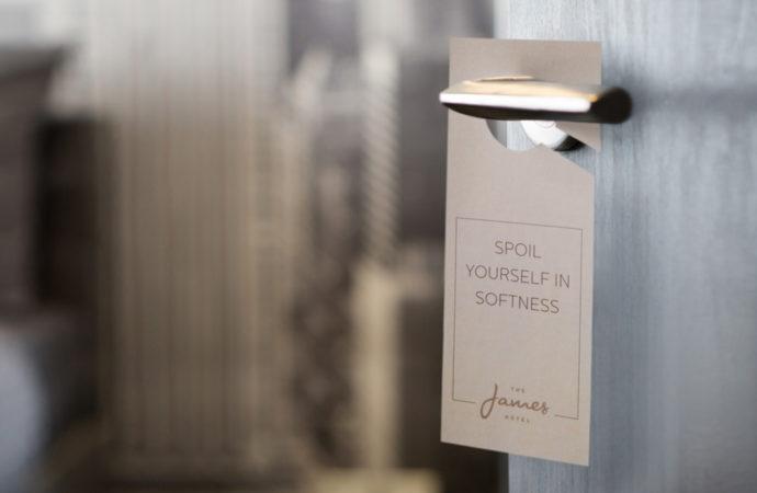 James Hotel Door Hanger that reads 'Spoil Yourself in Softness'